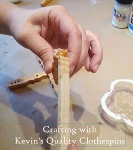 Gluing tips of snowflake together for clothespin craft