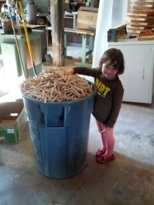 Little one with Bucket of clothes pin halves